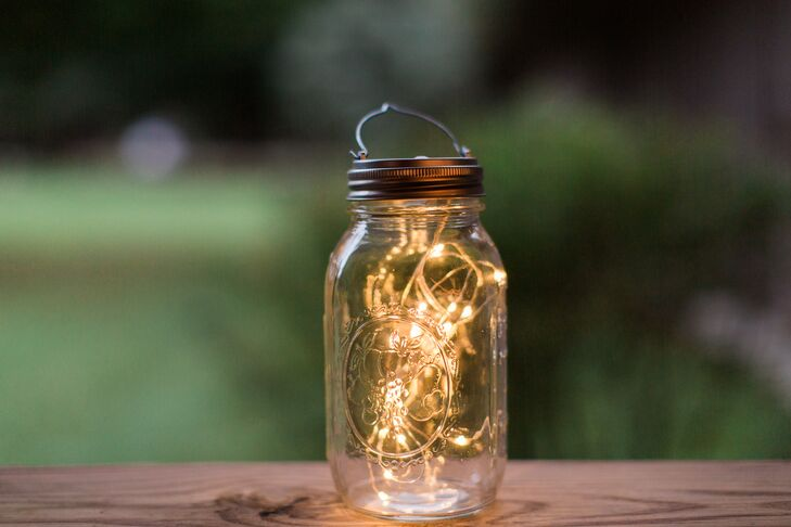 To create soft, ambient lighting, miniature string lights were stuffed inside glass mason jars. The flameless lighting was still as delicate as candlelight but a low-maintenance alternative to cope with the potential weather issues that come with an outdoor venue.