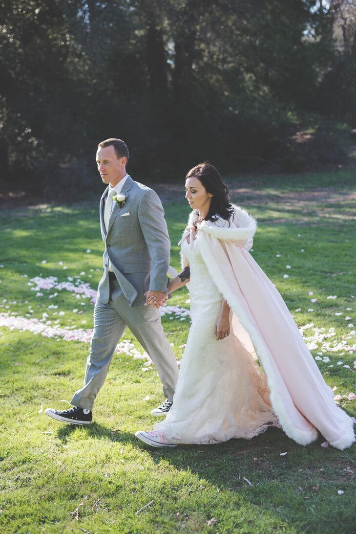 The couple walked while holding hands outside, with Sarah wearing a long blush fur cloak.