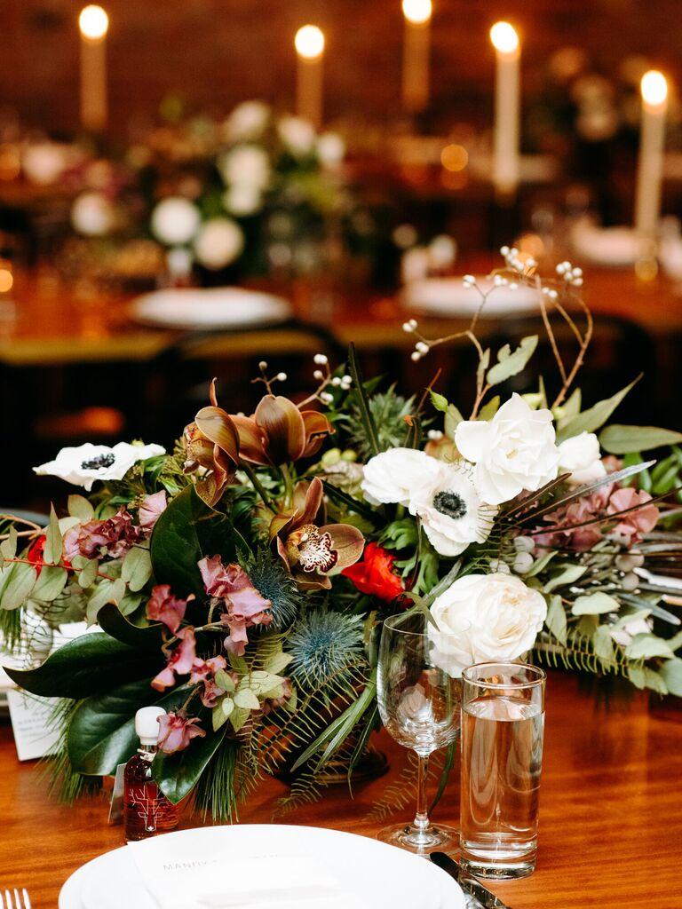 winter wedding ideas white red green centerpiece
