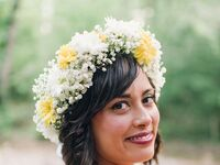 Short curls with side bangs and white/yellow flower crown