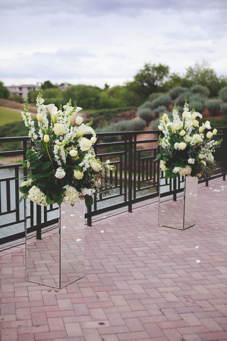 Tall White Flower Arrangements In Mirror Boxes