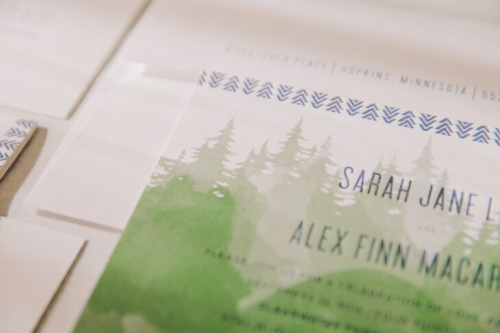 Camp-themed invitations set the tone for a fun and unique outdoor celebration.
