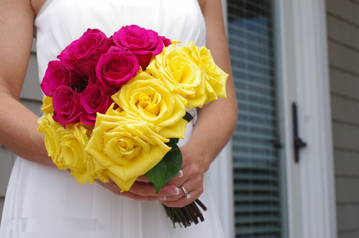 Amanda carried a vibrant bouquet of hot pink and yellow roses for her beach wedding.