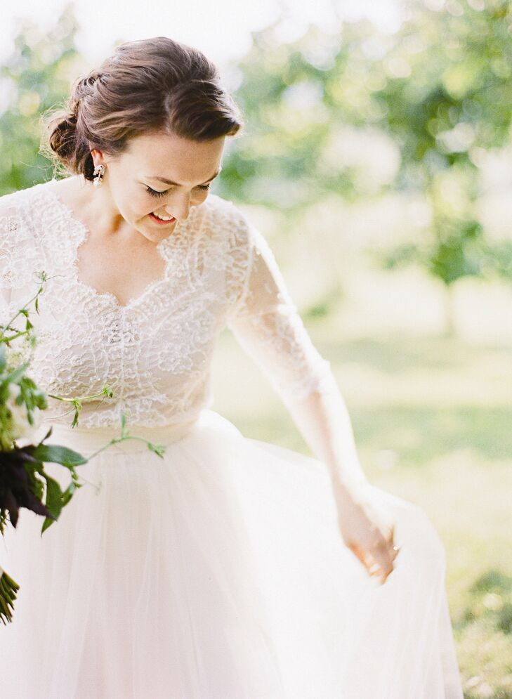 Augusta worked closely with designer Emily Riggs to create a custom variation on her Claire gown. Her dress was a one-of-a-kind two-piece, with a delicate lace top and a full tulle skirt.