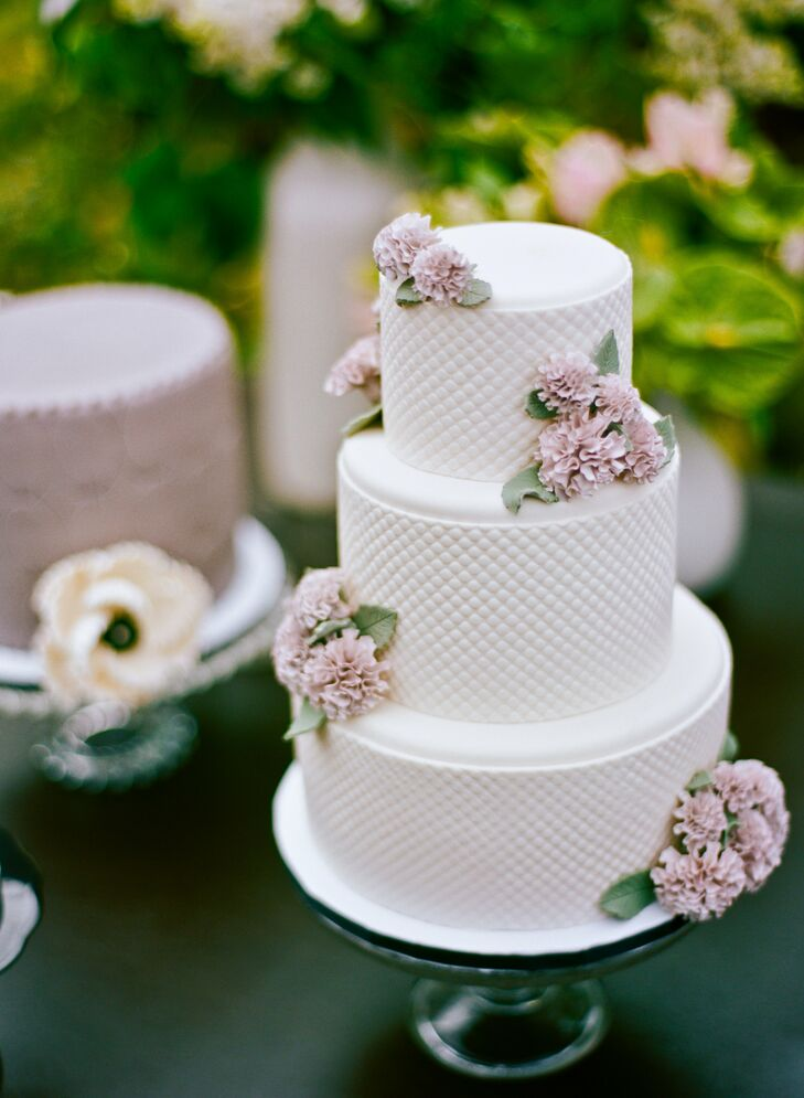 The elegant cake had a cushioned fondant pattern and muted blush florals gave it an artful appearance.