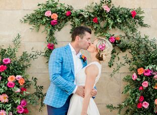 Samantha Daniel and Brian O'Neal drew inspiration from the summer season and their favorite colors—pink and orange—for their casual, laid-back wedding