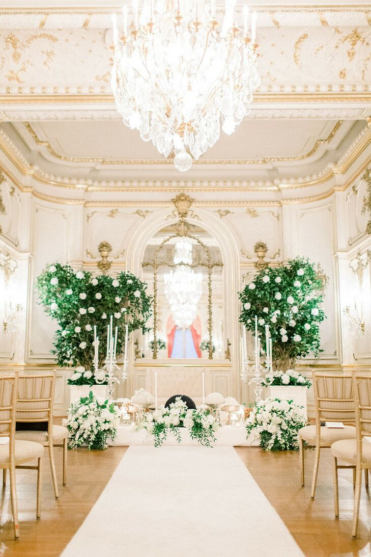 Luxurious Ceremony Site with White Flower Arrangements, Greenery and Chandelier