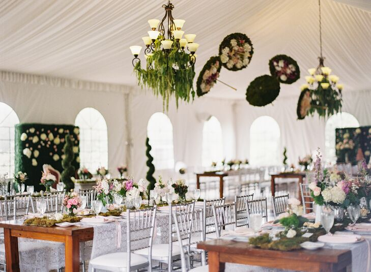 "The groom made whimsical moss umbrellas hanging above the dance floor, greenery was draped from the chandelier, and there were garden-inspired elements throughout the space. Seeing her vision come to life was emotional, Nicole says. ""I think a couple of tears welled up in my eyes."""