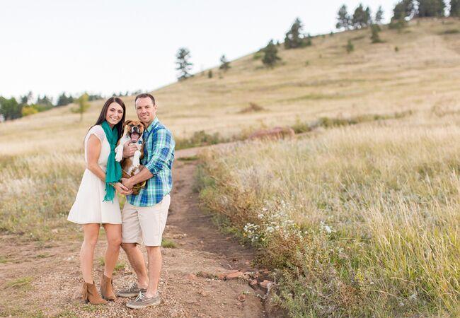 Engaged couple with dog