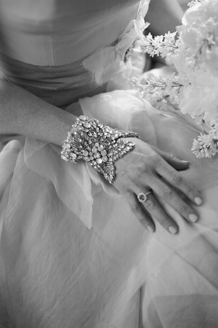 The bride kept her wedding day accessories simple—no veil, no headpiece, no necklace—with just a simple yet elegant bracelet and drop earrings found at  L'Atelier Couture Bridal Boutique in Minneapolis, Minnesota.