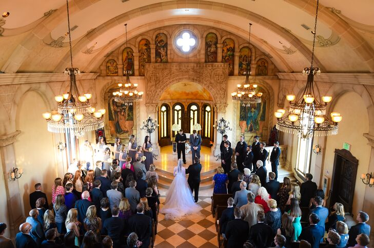 The ceremony took place at Bella Donna Chapel in Plano, Texas. The beautiful stone chapel is modeled after historic buildings in Croatia. Ornate chandeliers hung from the ceiling, and seating was provided in the form of 150-year-old wooden pews that were imported from Europe.