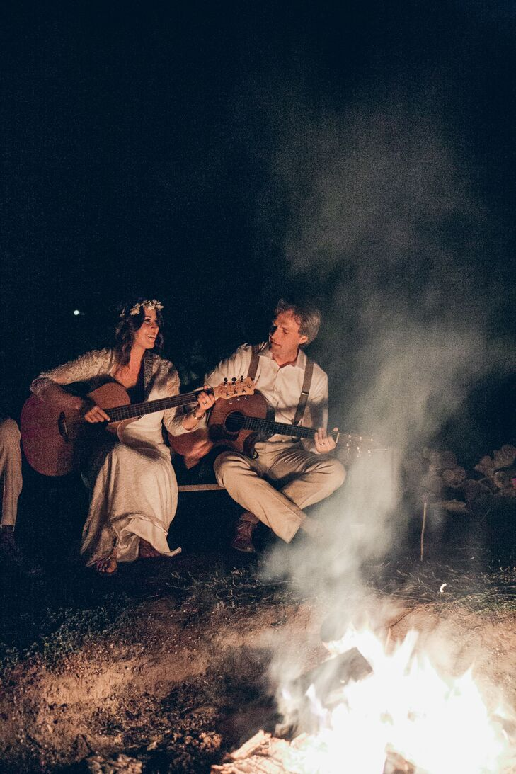 To close out the evening's celebration, Jayme and Jeremy sat around the campfire with their acoustic guitars for a singalong session with all their friends and family members.