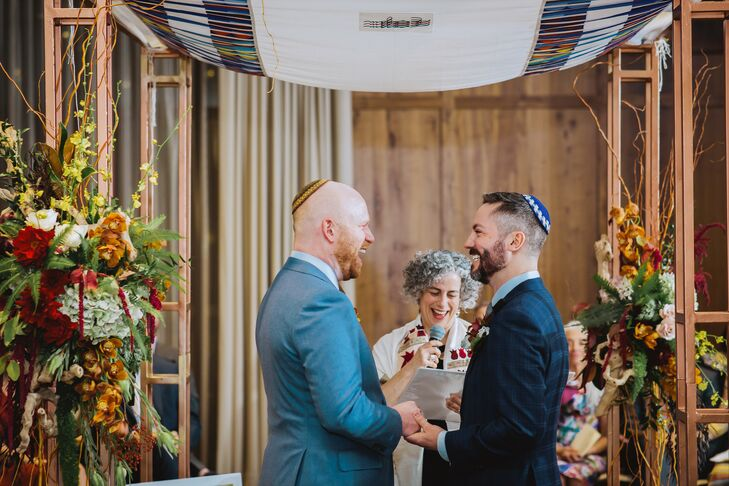 Grooms Holding Hands During Modern Jewish Ceremony