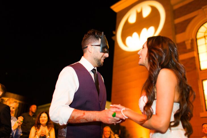 Guests donned Batman masks at dinner, and a Bat signal was displayed on the wall at Warner Brothers Studio in Hollywood, California.