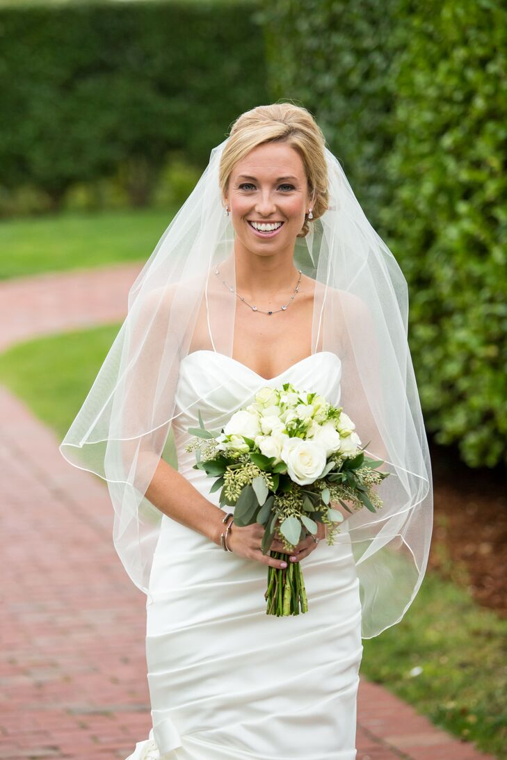 Following tradition, Alexandria added a fingertip-length blusher veil to her elegant updo for the ceremony.