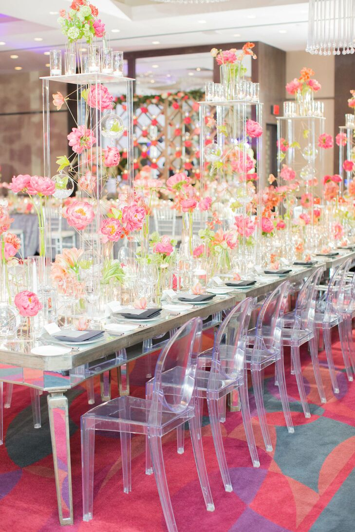The modern glass head table was decorated in pink peonies.