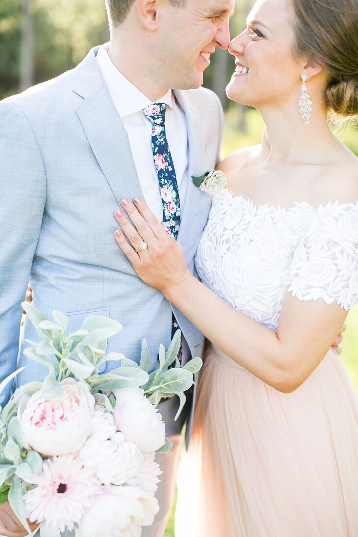 "In another nontraditional touch, Aaron wore a powder-blue suit that stood apart from his side of the wedding party. ""We chose a soft blue which was different than the gray suits of the groomsmen but in a subtle way,"" Julie says. ""Much like my dress was different than the bridesmaids, but not starkly contrasting."""