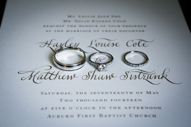 """""""I have always loved the look of custom calligraphy, so we used a calligrapher to address the invitations and create the headings for our invitation suite,"""" Hayley says. """"By just using bits and pieces of the calligrapher's writing, we were still able to create that special, classic touch, but also saved money by not having the entire invitation in custom calligraphy."""""""