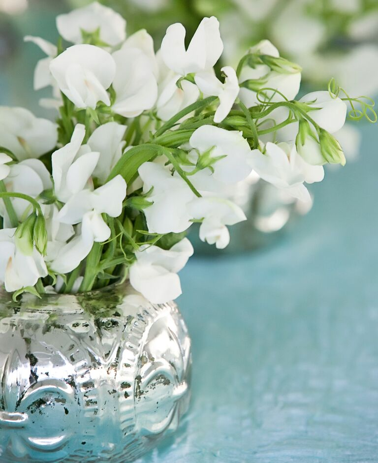 White sweet pea reception table decor