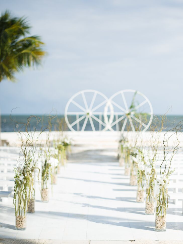 Casual Beach Aisle Lined with Vases with Branches