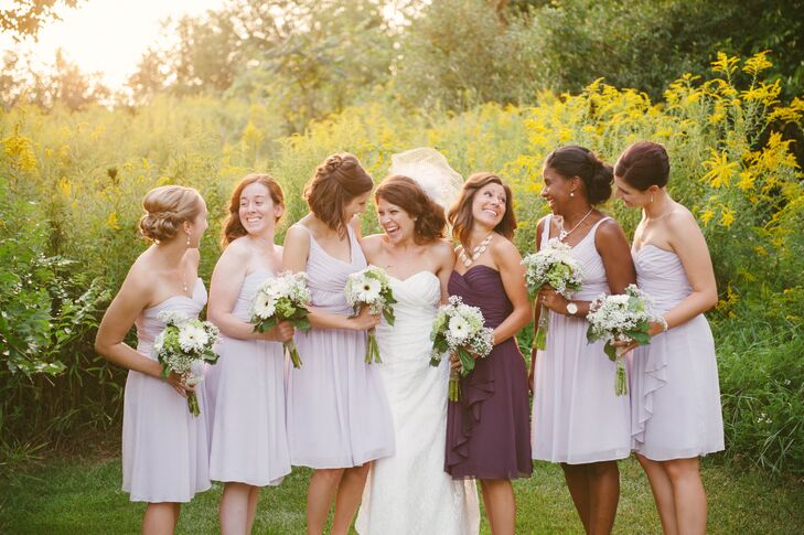 Katie let her bridesmaids choose from a variety of dress styles so that everyone felt comfortable at the ceremony. Katie's sister, her maid of honor, wore a plum-colored dress, which complemented the lavender.