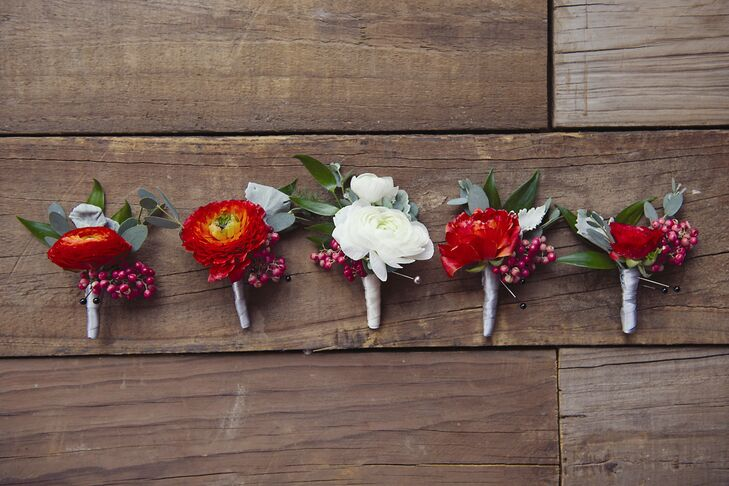 The ranunculus boutonnieres were accented with tiny red berries.