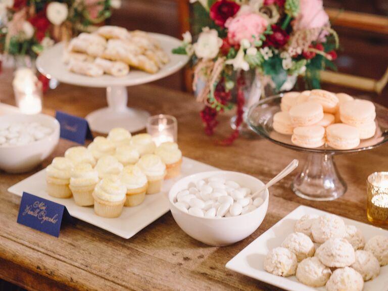 Wedding dessert bar station with floral arrangements