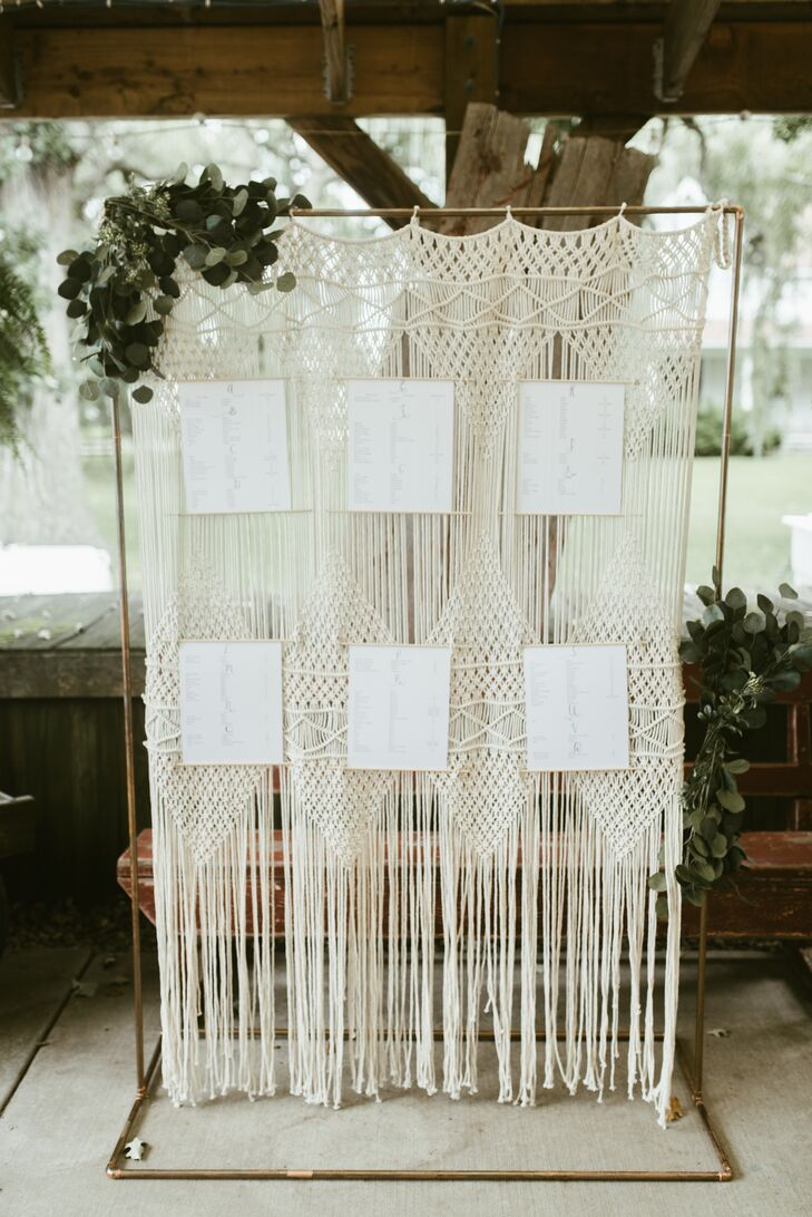 Guests' seating assignments were hung on a macramé backdrop positioned at the reception entrance.
