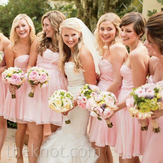 The pale-pink hue of the bridesmaids' silk chiffon dresses led the day's palette