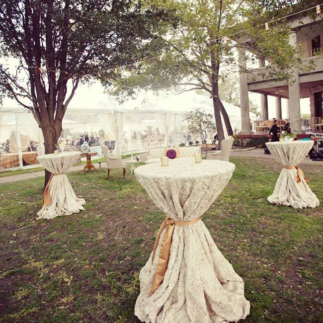 Cocktail tables were set up outside the reception tent and dressed in rich, rosette-patterned tablecloths for a decidedly vintage touch.