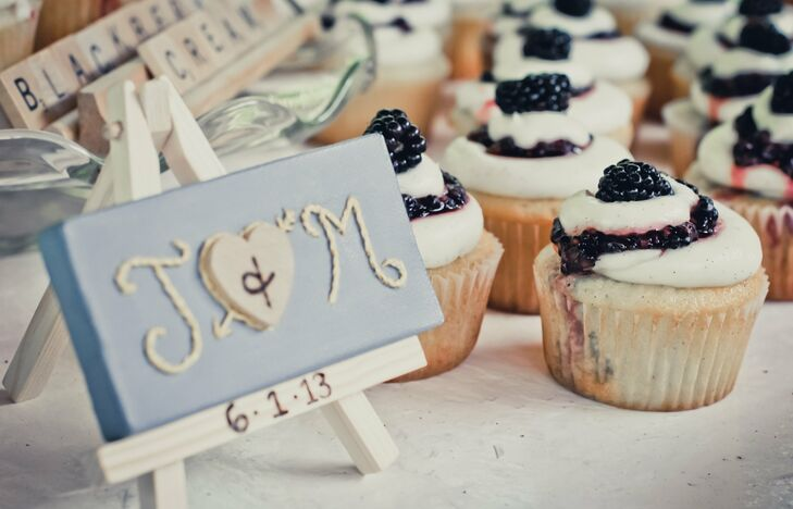 A miniature painter's easel with Megan and Josh's initials and wedding date painted onto it was the centerpiece on the dessert table.