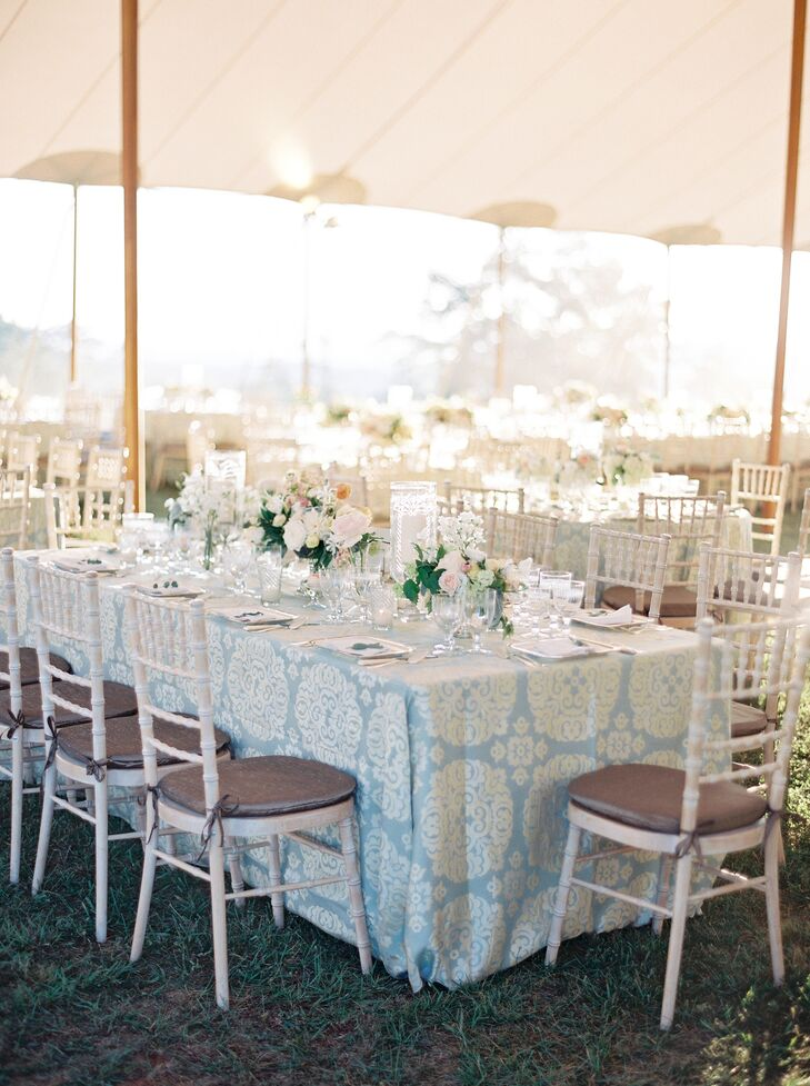 An assortment of round and rectangular tables were topped with jacquard linens in dusty blue and cream.