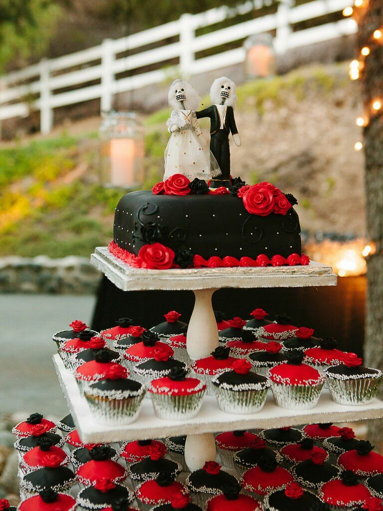 Small black wedding cake with black and red cupcakes