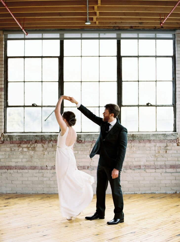 Bride and Groom Sharing Private Dance at Industrial Venue