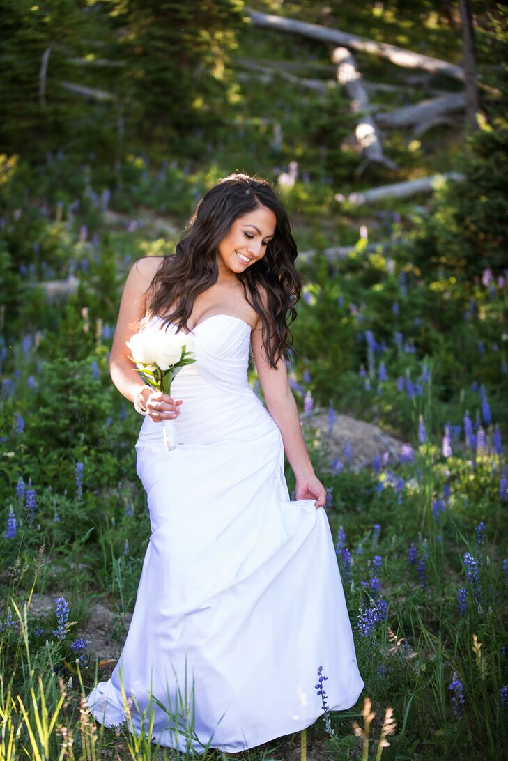 """Crystal chose a stunning Stella York wedding dress for her rustic nuptials. She loved the satin fabric and form-fitting silhouette. """"I wanted to stick with the old saying, 'Less is more,' """" Crystal says. She added a touch of bling to her look with a rhinestone bracelet and earrings."""