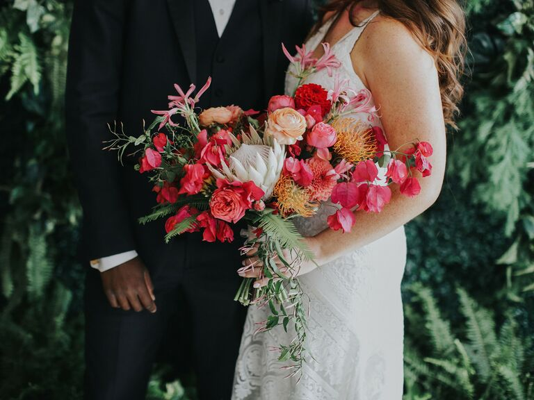 most popular wedding colors couple holding colorful bouquet