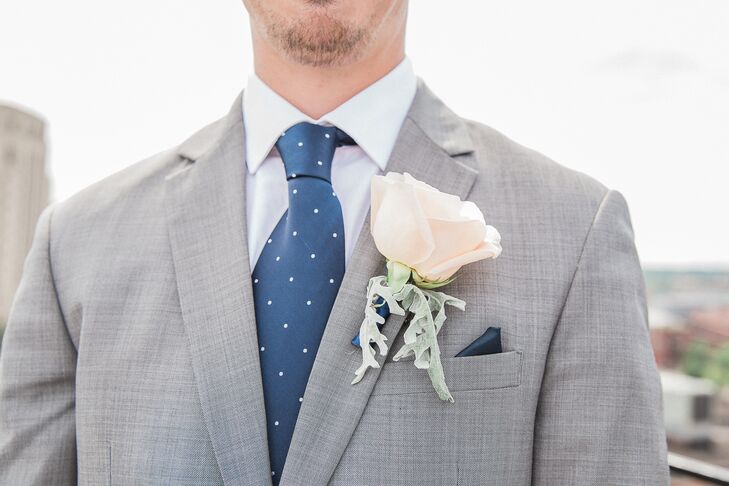 Each color in the wedding's palette—navy, blush and silver—was incorporated into Adam's style, from his boutonniere to his polka-dot tie.