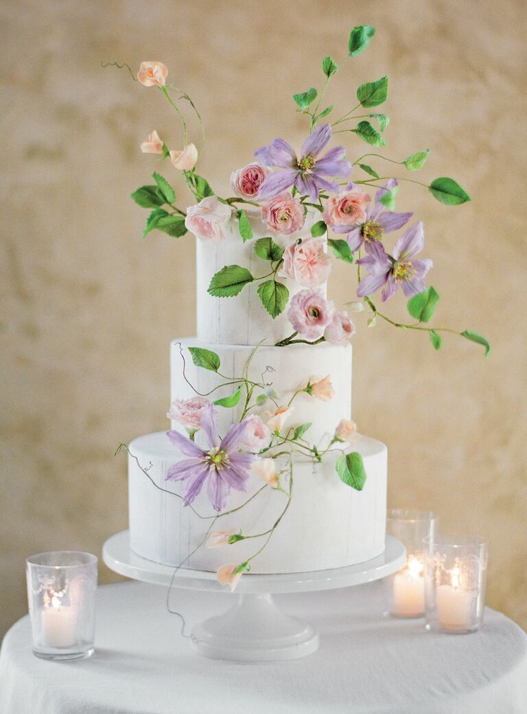 White cake with paper flowers by Maggie Austin Cake