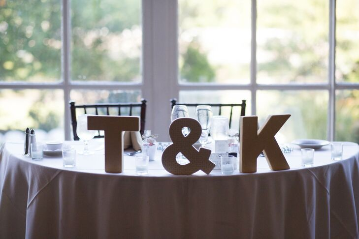 Todd and Karen opted to forgo florals on the sweetheart table, choosing kraft paper letters and ampersand to signify their special seats.