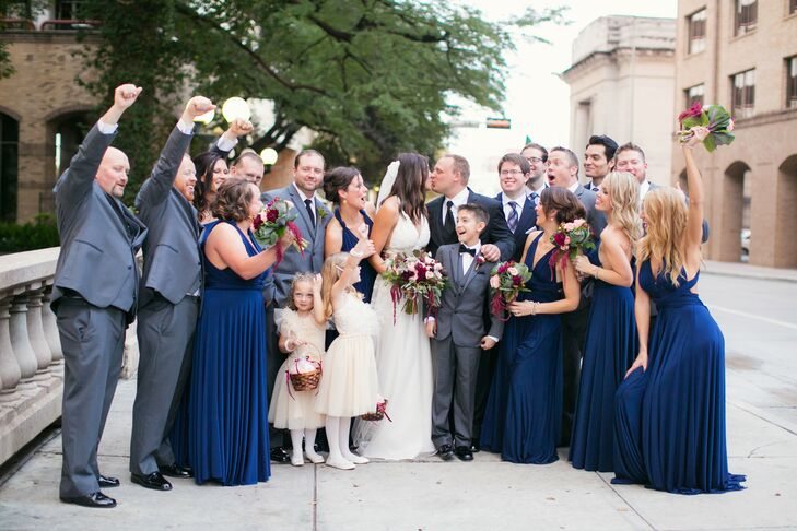 The Arneson River theater, along with the San Antonio Riverwalk, provided a cultured, natural beauty for the ceremony. Candace and Casey went with an elegant vintage theme and a color palette of maroon, navy and champagne.