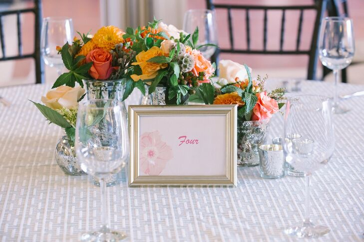 Simple framed table numbers were decorated with a print of a single tropical flower.