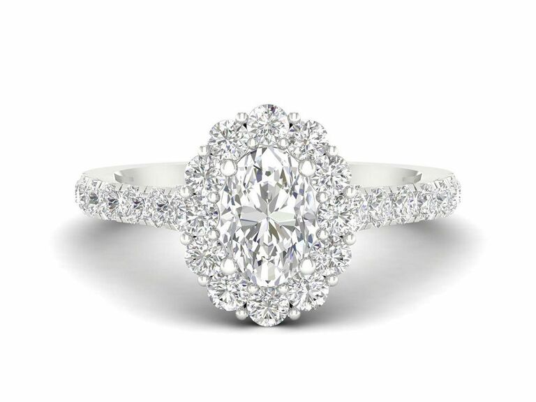 Jenny Packham oval diamond engagement ring with a floral-inspired halo and diamond pave band