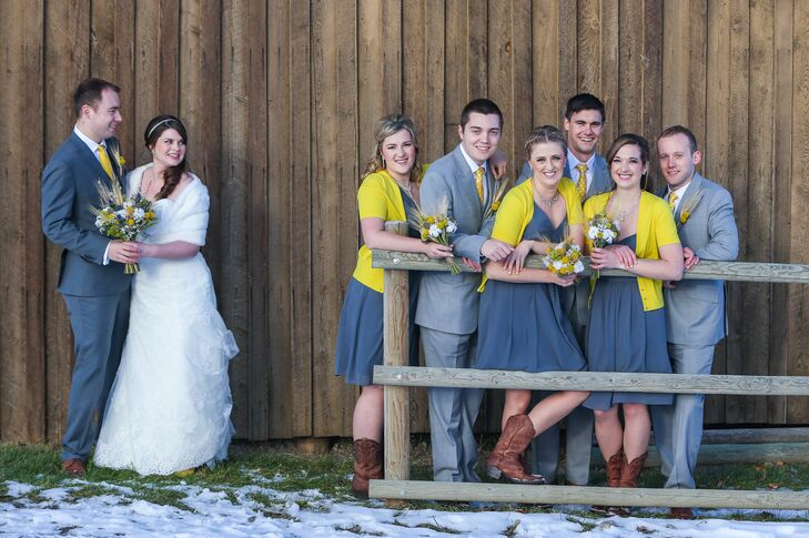 The bridesmaids wore gray one shoulder chiffon dresses with a yellow cardigan.