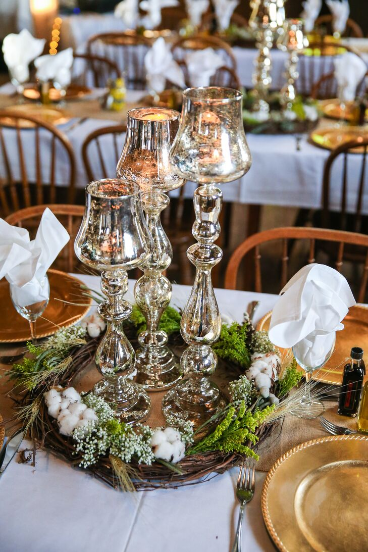 Mercury glass candelabras were framed by rustic wreaths made of cotton, twigs, Baby's Breath and assorted greenery.