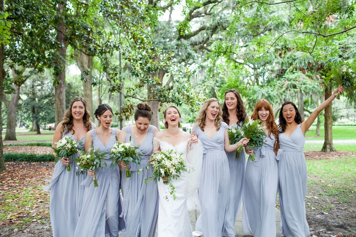 Faith and her bridesmaids picked their bridesmaids dresses from Union Station in New York City. They all wore the same gorgeous style of a blue gray dress that beautifully fit the natural wedding ambience.