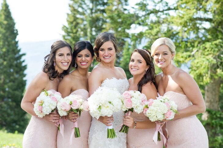 Bridesmaids in Blush Gowns Carrying Hydrangeas and Roses