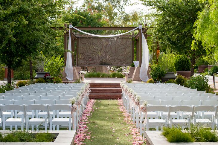 The ceremony arch was loosely draped with white chiffon, adding a touch of elegance.