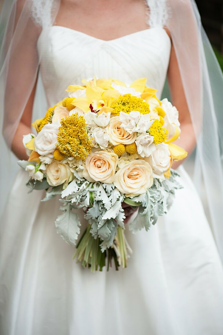 Heather carried a stunning bouquet of rustic and romantic flowers. Bright yellow orchids, billy balls and yarrow flowers added a hint of vibrancy to feminine pastel roses and dusty miller.