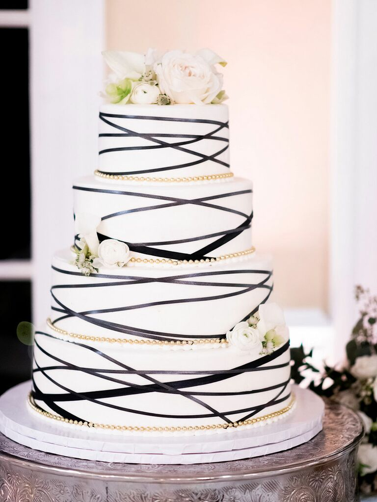 White wedding cake with black abstract lines and gold details