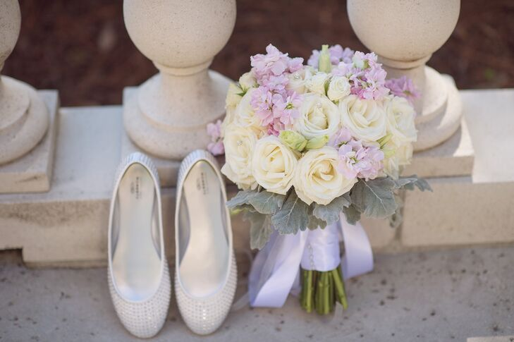 """Abbey carried a bouquet of pale yellow garden roses, dusty miller and lavender accents. """"I love dusty millers and definitely wanted them included in all of the bouquets, boutonnieres and arrangements,"""" says Abbey."""